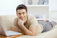 Man using laptop at home Royalty Free Stock Image