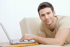 Man using laptop at home Royalty Free Stock Photos