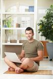 Man using laptop at home Royalty Free Stock Photo