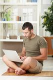 Man using laptop at home Stock Image