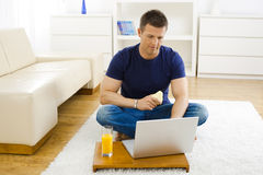 Man using laptop at home Stock Photography