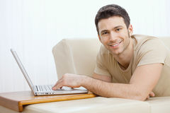 Man using laptop at home Stock Photo