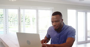 Man using laptop. At home stock footage