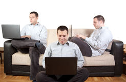 Man using Laptop at home on a couch Royalty Free Stock Photo
