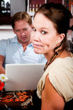 Man using laptop ignoring his date in coffee house Royalty Free Stock Images