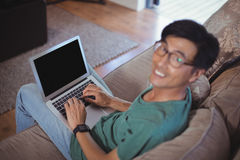 Man using laptop in living room Royalty Free Stock Images