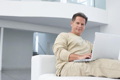 Man Using Laptop In Living Room Royalty Free Stock Photo