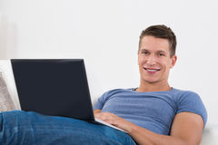 Man Using Laptop In Living Room Royalty Free Stock Image