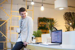 Man using laptop in office Stock Photography