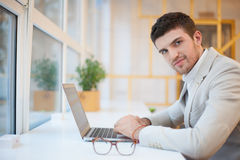 Man using laptop in office Royalty Free Stock Image