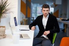 Man using laptop in office Stock Photos