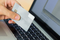 Man using laptop for online shopping Royalty Free Stock Image