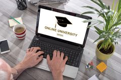 Online university concept on a laptop. Man using a laptop with online university concept on the screen royalty free stock images