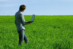 Man using a laptop outdoors Royalty Free Stock Images