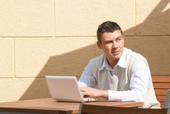Man using a laptop outdoors Royalty Free Stock Photos