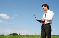 Man using laptop outdoors Royalty Free Stock Image
