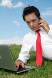 Man using laptop outdoors Stock Photography