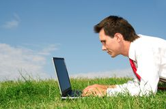 Man using laptop outdoors Royalty Free Stock Images