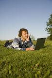 Man using a laptop outdoors. At the evening Royalty Free Stock Photography