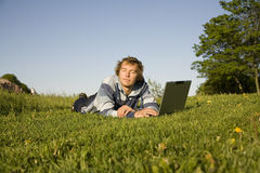 Man using a laptop outdoors Stock Photos