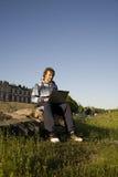 Man using a laptop outdoors Stock Photos