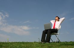 Man using laptop outdoors Royalty Free Stock Photography