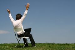 Man using laptop outdoors. Man sitting in chair outdoors Stock Photos