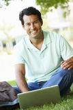 Man using laptop outdoors Stock Photo