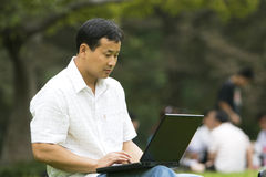 Man using a laptop outdoors Royalty Free Stock Image