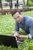 Man using laptop at park Royalty Free Stock Photo