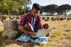 Man using laptop in the park Stock Image