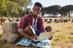 Man using laptop in the park Royalty Free Stock Photo