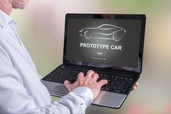 Prototype car concept on a laptop. Man using a laptop with prototype car concept on the screen Stock Photos