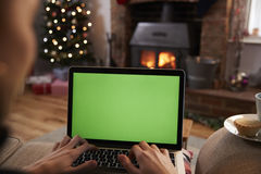 Man Using Laptop In Room Decorated For Christmas Royalty Free Stock Photo
