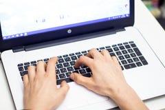 Man using laptop, searching web, browsing information,. Having workplace at home stock image
