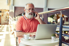 Man using laptop and smartphone Royalty Free Stock Image