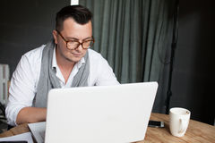 Man using laptop in startup office Stock Photos