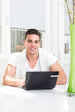 Man using laptop on the table in the living room atmosphere Stock Photo