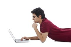 Man using laptop and thinking Stock Images