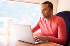 Man Using Laptop On Train Royalty Free Stock Photo