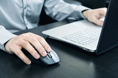 Man using laptop with white keyboard Royalty Free Stock Photo
