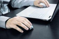 Man using laptop with white keyboard Stock Photo