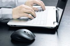 Man using laptop with white keyboard Stock Photography