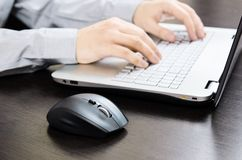 Man using laptop with white keyboard Royalty Free Stock Photography
