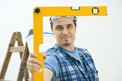 Man using level tool Royalty Free Stock Photography