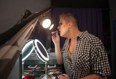 Man Using Lipstick Pencil Royalty Free Stock Photo