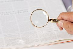 Man using magnify glass looking for jobs Stock Photos