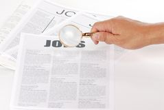 Man using magnify glass looking for jobs Royalty Free Stock Photos