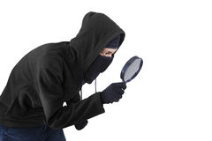Man using magnifying glass for spying Stock Photo