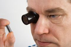 Man using a magnifying loupe Stock Photos